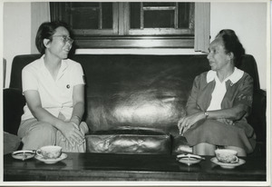 Shirley Graham Du Bois sitting on a couch with an unidentified woman