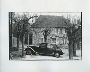Car parked in front of stone house in France