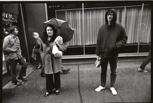Vietnam Veterans Against the War demonstration 'Search and destroy': man and woman watching demonstration on Washington Street