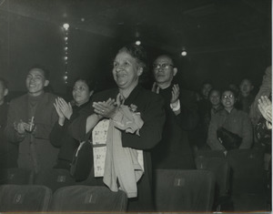 Shirley Graham Du Bois applauding in an audience