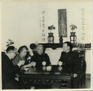 Shirley Graham Du Bois drinking tea with three unidentified Chinese officials