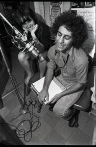 Abbie Hoffman: unidentified woman and Hoffman (right) at the microphone, WBCN studio