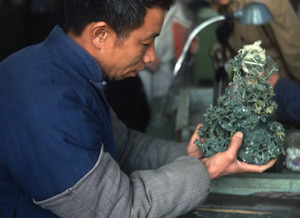 Jade worker polishing