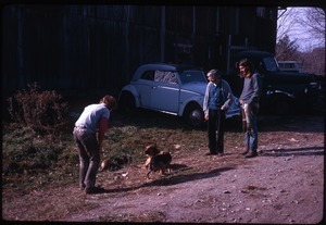 Tony Mathews (far right), Alex Kelly (center), Rick, and Burn, the dog