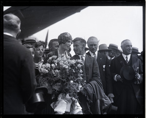 Amelia Earhart reception: Earhart with bouquet of flowers and Wilmer Stultz (pilot), Mayor Edward H. Larkin of Medford, and Gov. Alvan T. Fuller (l. to r.)