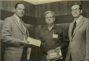 Randolph Bromery presenting award to unidentified campus worker