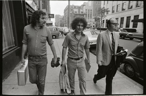 Abbie Hoffman and George Kimball walking along the street