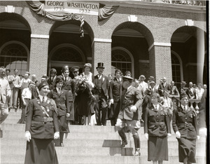 Amelia Earhart reception: Earhart with bouquet of flowers, standing atop the Massachusetts State House steps with entourage