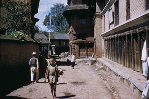 Boy walking down street in Patan