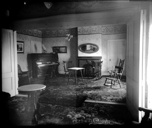 Interior of a parlor in an unidentified house (possibly the Lake Pleasant Hotel)