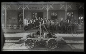 Hand car and rail workers at Lake Pleasant (?) railroad station