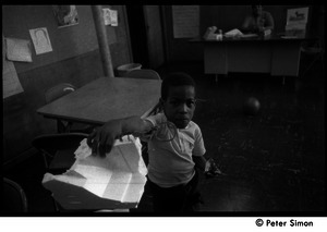 African American boy in the Liberation School classroom
