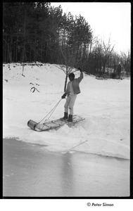 Party at Jackie Robinson's house: boy riding sled