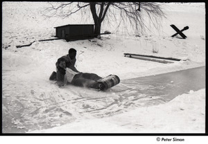 Party at Jackie Robinson's house: boys riding sled