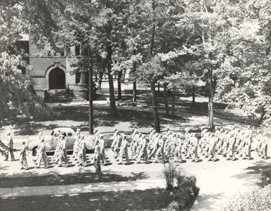 Army Air Corps trainees marching down Hickory Street (June 1943)