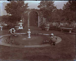 Children playing by the garden pool of the Saltonstall House, Milton, Mass.
