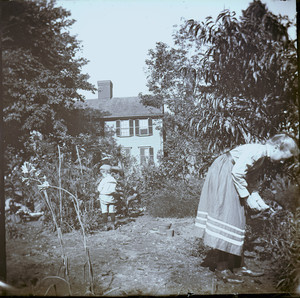 Alice Train Brown and John Freeman Brown, Jr. playing in the garden of the John Crehore House, Milton, Mass.