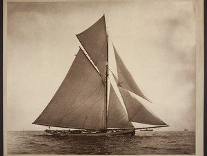 Gaff-rigged sailboat under full sail