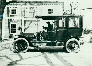Automobile parked in front of Codman House carriage house, Lincoln, Mass.