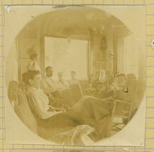 Group portrait of the Tucker family seated indoors