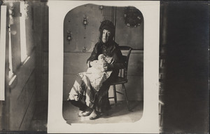 Full-length portrait of Nancy Luce, seated, facing front, holding her pet hen, West Tisbury, Mass., undated