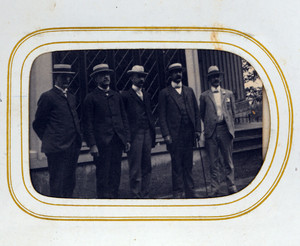 Full-length group portrait of the five Bowen brothers, facing front, location unknown
