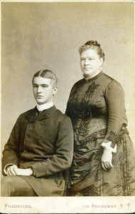 Three-quarter double studio portrait of Ellen Holt Bowen and Paul Holt Bowen, facing front, location unknown