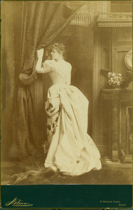 Full-length portrait of Lillie Langtry, standing, left profile, holding on to a curtain, Notman, 99 Boylston Street, Boston, Mass., 1886-1887