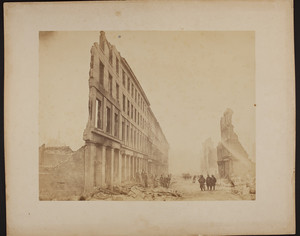 Firemen in the street outside a numbered building facade, 1872