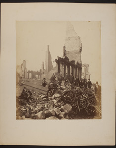 Group of men stand in the ruins of the Boston fire, 1872
