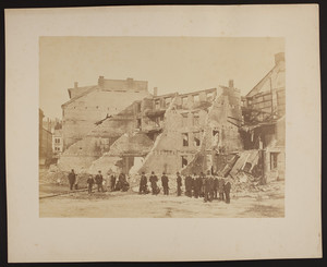 Group of men in front of a building ruin, 1872