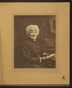 Half-length portrait of Mary Perkins Olmsted, seated, facing front, holding a book, undated
