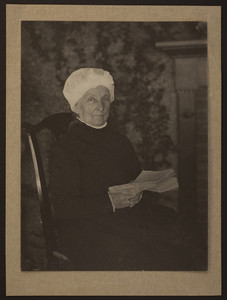 Three-quarter portrait of Mary Perkins Olmsted, seated on a chair, facing front, holding a book, undated