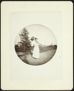 Woman with a view camera, location unknown, undated