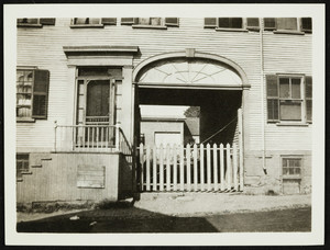 Exterior view of an unidentified building, with an archway, Portsmouth, N.H., undated