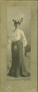Full-length portrait of unidentified woman, standing, facing front, location unknown, ca. 1890