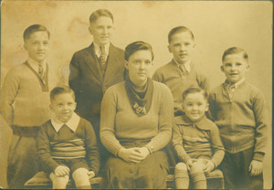 Group studio portrait of an unidentified woman and six boys, 1930s