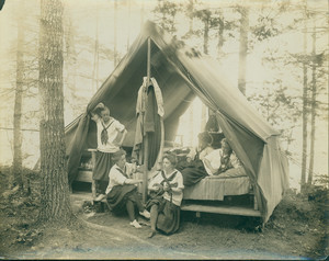 Girls resting in their tent, Denmark, Maine, undated