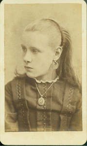 Head-and-shoulders portrait of a girl, looking left, location unknown, undated