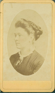 Head-and-shoulders portrait of a woman, facing left, location unknown, undated