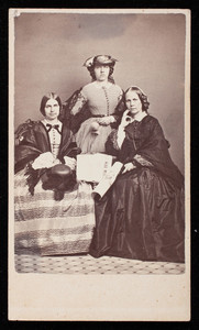 "Group portrait of Isabella Pelham Curtis (standing), Frances Greely Stevenson (seated on the left) and ""Aunt Margarite"" (seated on the right), location unknown"