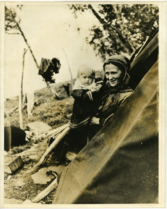 A Lapp mother with her baby, in the tent