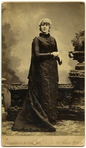 Full-length studio portrait of Martha E. Otis (Mattie O. Dickinson)