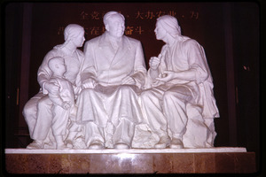 Agricultural exhibition(?): sculpture of Mao seated with a family