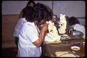 Arts and crafts factory: worker carving ivory