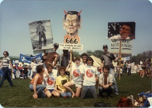 UMass Peacemakers contingent at the 'Four Days in April' demonstration in Washington D.C., holding image of Ronald Reagan with devil's horns and caption '666 The bombing begins in five minutes'