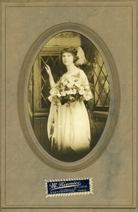 Polish American woman with bouquet of flowers: three quarter-length studio portrait in oval folder