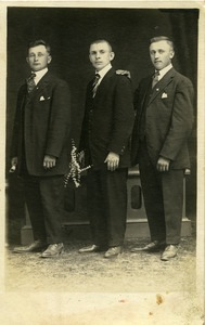 Jan Lesinski (center) and two unidentified men: full-length studio portrait