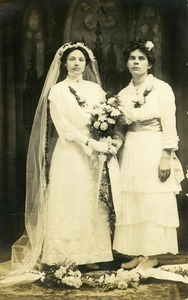 Polish American bride and bridesmaid, Weronika Skedzielewska and Weronika Rusin Lesinska (l. to r.): full-length studio portrait