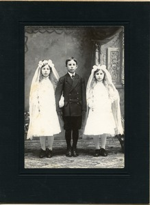 Boy and two girls at first communion, possibly Easthampton, Mass.: full-length studio portrait